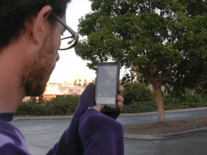 Photo of citizen scientist using mobile imaging app