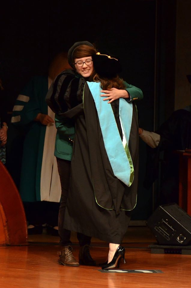 meghan hugs graduation
